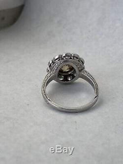 Antique platinum Edwardian fancy brown and colorless old European diamond ring